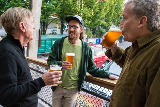 Tom Murphy discusses his plans for Barb's Beer with Boundary Bay Brewery Bryan Krueger while Chuck Hohing, original recipe writer, sips Barb's Beer.